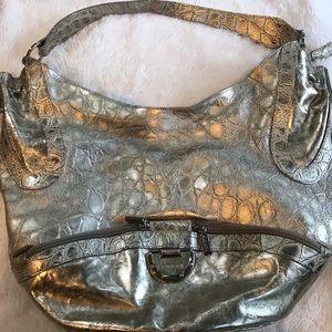 Ladies gently used silver handbag